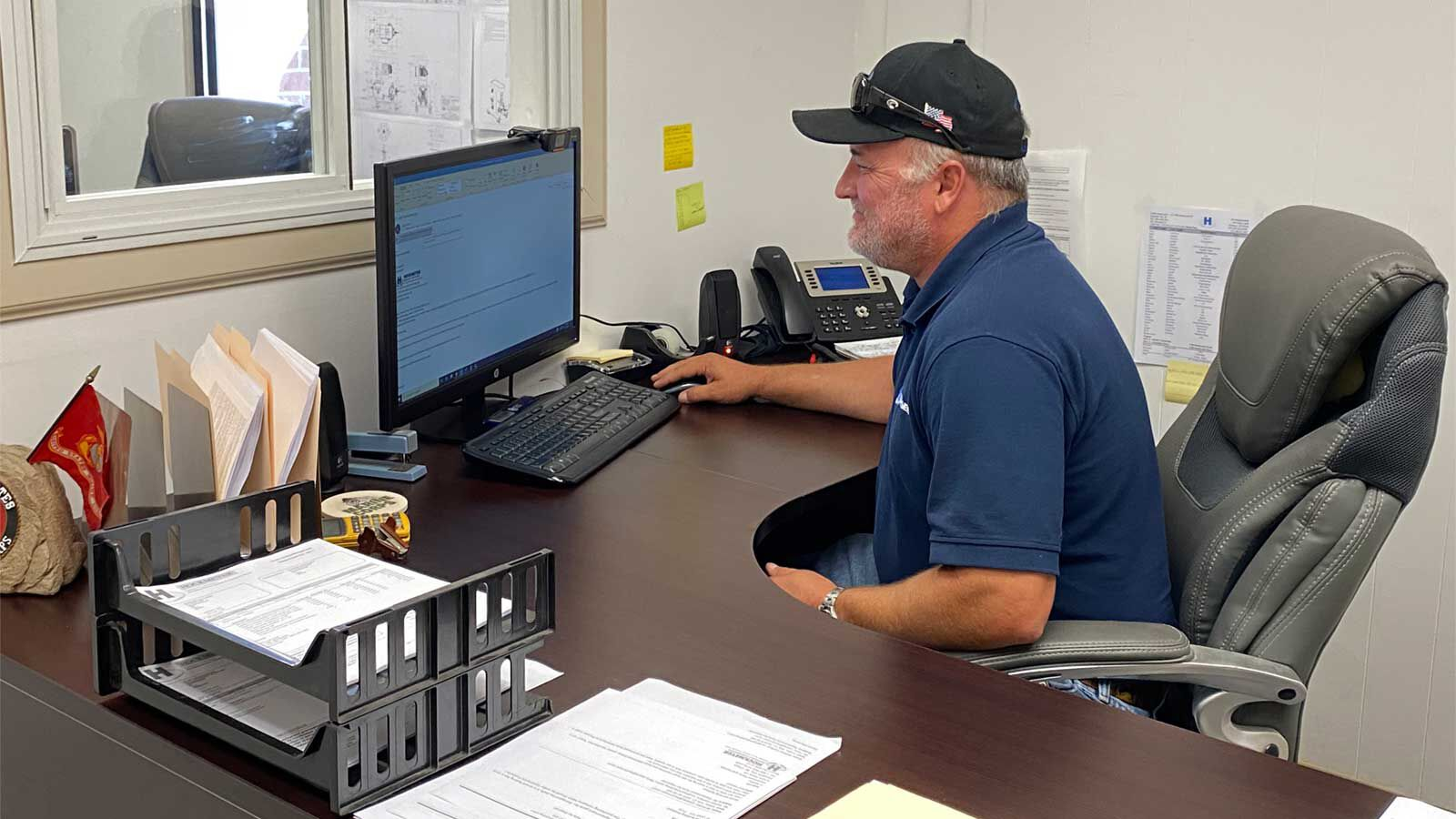 A Parts & Service employee answering emails from a client of Hockmeyer Equipment Corporation